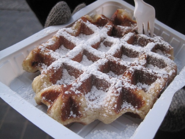 Having a sugar-dusted Belgian waffle in Belgium
