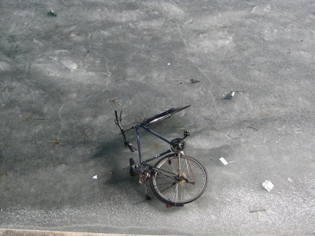 A lost bicycle, blown away by the wind maybe? How would the owner retrieve it?