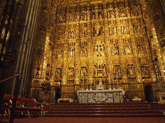 """The main altar's 15th century altarpiece, the world's largest. (Notice how the word """"large"""" features often in this cathedral?) Composed of 45 Bible scenes with over 1,000 characters."""